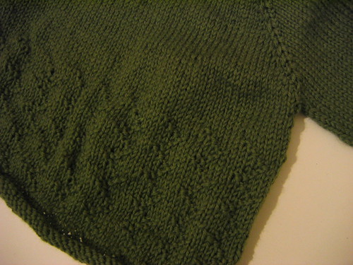 green baby jumper - close up