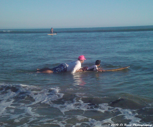 The Next Generation Takes His First Paddle Out to the Break