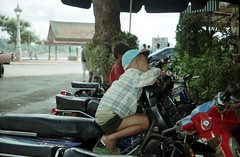 Young bikers (Linda DV) Tags: 2001 travel people cute barn children geotagged kid asia cambodia child young culture kind phnompenh criana enfant nio dziecko bambino    lapsi copil dijete  dt    culturaltravel lindadevolder  photonegativescan