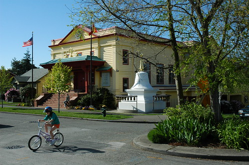 Early spring cyclist braves the curve near Sakya Monastery of Tibetan Buddhism, Seattle, Washington, USA by Wonderlane