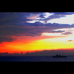 a moment sublime (DocTony Photography) Tags: ocean sunset sea sun canon bay boat twilight bravo philippines manila manilabay bff 30d interestingness111 magicdonkey supertony flickrsbest specsky 70200f4is henyo superaplus aplusphoto doctony thegoldenmermaid