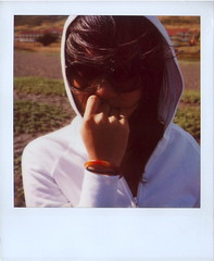 Cassandra on the Beach (Lou O' Bedlam) Tags: beach sunglasses asian polaroid hoodie headlands cassandra nailbiter roidrage polaroid680 louobedlam 63007 lounoble louobedlamcom