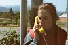Long Distance (XTheFisch) Tags: california portrait mountains film 35mm glasses payphone teenager vista rollinghills younggirl lostcoast yellowphone callinghome omenous checkingin zeiss50mm ektar100 filmscansnumber7