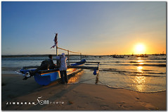 sunset - Jimbaran Beach Bali (fiftymm99) Tags: sunset sea people bali water lady boat seaside fishing fisherman sand nikon mother wave son jimbaran d300 fiftymm fiftymm99