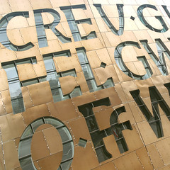 Millennium Detail (Adam Clutterbuck) Tags: windows colour metal wales poem centre letters cardiff millenium oe inthesestoneshorizonssing greengage creugwirfelgwydroffwrnaisawen gwynethlewis openedition