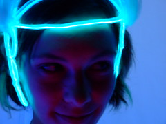 Rachel's White Party Costume Headpiece (In dust we trust) Tags: city blue portrait black rock night lowlight playa el burningman finepix fujifilm whiteparty 2007 electroluminescent elwire opulenttemple s6000fd colourartaward