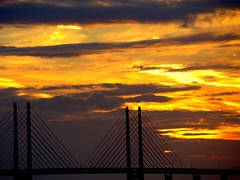 oresund bridge and the burning sky. (Arun Jr) Tags: travel bridge light sunset sky beautiful night clouds dawn skne interesting europe nightlights sweden sony scandinavia malmo naturesfinest skane oresundbridge diamondclassphotographer flickrdiamond dsch9 arunjrk