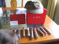 My dog, Rommel, is looking at my prize winnings from CAO Cigars. I think he wants to try some out.