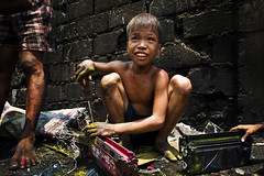 Smoky Mountain - Scavenging for Ink Cartridge (Mio Cade) Tags: poverty boy mountain toxic ink kid child philippines environmental social powder manila smoky recycling scavenger cartridge dispose tondo scanvenging