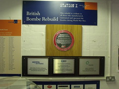 Photo of The Bombe, Alan Mathison Turing, Gordon Welchman, and Harold Keen red and black plaque