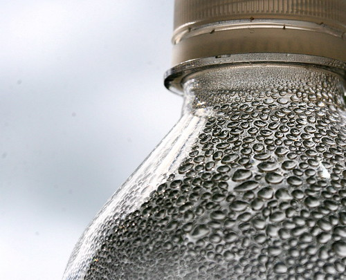 Close up of water bottle with beads of condensation