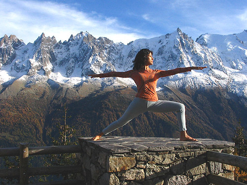 Woman practicing yoga in the Alps in France