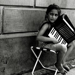 Sad song (Mik Thorvaldsen) Tags: poverty blackandwhite bw music berlin girl eyes child sad song poor streetportrait bn nostalgia musica biancoenero globalvillage tristezza nostalgy povert berlino globalcity invitedphotosonly gvadminshalloffame itsabeautifulgv mikel1983 micheletorsello niosydetalles