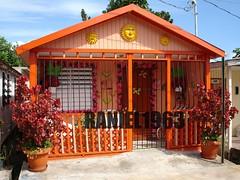 Houses in Dorado Puerto Rico (raniel1963) Tags: orange sol casa puertorico mariposas soles isla casita anaranjado adornos isladelencanto portorico borinquen floresartificiales housesdoradopuertoricosunborinquenisladelencantopuertoricoartartecolor raniel1963raniel1963raniel1963