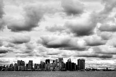Clouds Over New York (dennoit) Tags: city newyorkcity bridge blackandwhite cloud newyork building skyline architecture skyscraper river cityscape manhattan eastriver hudsonriver cityline