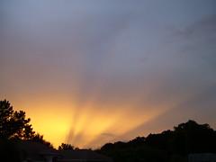 Sky on Fire (38 LN 38) Tags: sunset sky rays blue yellow orange black frontyard dramatic nature personalfavorite wallpaper desktopwallpaper sunsetwallpaper