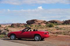 Near Slick Rock Moab (D70) Tags: red usa classic utah near top convertible down na topless topdown moab slickrock miata dropped exposed 1990 roadster mazdamx5 miatasinmoabiv
