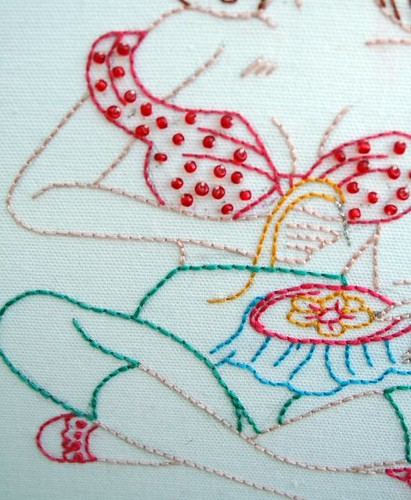 Up close embroidering pin-up