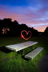 first kiss (night photographer) Tags: light bench painting heart reallynicesky