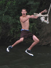 A Flying Leap into the Creek (Sandra Leidholdt) Tags: boy summer usa fall sports america fun golden us jump jumping colorado unitedstates action falling explore teen american teenager recreation leap amricain clearcreek explored sandraleidholdt leidholdt sandyleidholdt
