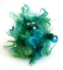 i so fuzzeh. (made by moxie) Tags: green wool goofy felted whimsy fuzzy needle fiber roving bff fingerpuppet needlefelted dryfelting dryfelted madebymoxie fuzzeh aintgotnocomb hollyeqqneedlefelted