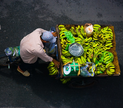 Man on a bike selling bananas, Saigon