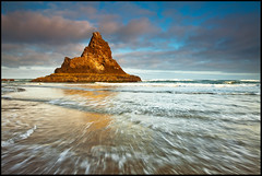 Wizards Hat (Darren White Photography) Tags: ocean clouds oregon sunrise canon landscapes northwest pacificocean pacificnorthwest oregoncoast seastacks 1740l darrenwhite darrenwhitephotography 5dmkii