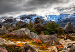 A Rocky Morning (Stuck in Customs) Tags: morning travel wild panorama patagonia mountain mountains cold fern argentina argentine clouds digital america outdoors photography blog high bush colorful republic dynamic stuck natural hiking stones south scenic rocky el boulder hike foliage boulders photoblog software processing andes april imaging stony wilderness icy obscured frigid range 2009 hdr repblica tutorial travelblog customs argentino chalten crag cerrotorre losglaciaresnationalpark santacruzprovince riodelasvueltas cerrofitzroy elchaltn hdrtutorial stuckincustoms rodelasvueltas photographyblog stuckincustomscom nikond3x reservanacionalzonaviedma