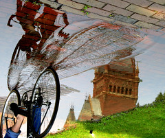 through a world turned upside down (sandcastlematt) Tags: cambridge urban reflection brick art bicycle puddle cycling upsidedown massachusetts harvard contest april harvarduniversity topf100 palindrome memorialhall bostonist bostoncom universalhub guesswhereboston foundinboston