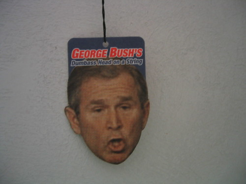 george bush's dumbass head on a string
