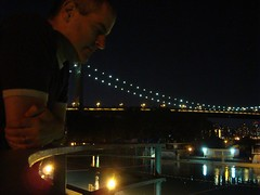 Serious Bill (Super Happy Eats) Tags: nyc newyorkcity bridge blue light man reflection water glass pool night dark astoria astoriapark triborobridge
