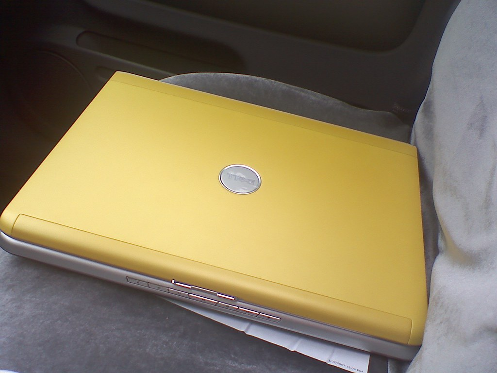My Sunshine Yellow Dell Inspiron 1721  (paid off 6/21/09 - A Father's Day gift to myself!)