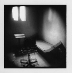 Solitary x 2 (Otto K.) Tags: atlanta bw abandoned window table polaroid blackwhite holga bed chair cell center double prison jail isolation holgaroid solitary deserted decayed pretrial detention blackribbonbeauty ottok