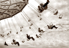 the flight in the clouds sepia (riisli) Tags: people sepia clouds action roundabout zrich knabenschiessen supershot goldenphotographer flickrelite excapture theperfectphotographer