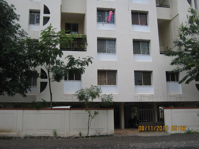 Pinnacle Cottage Close at 'Abhiruchi Village' on Sinhagad Road Pune 411 041 - Rawat Brothers' Radhanagari Phase 1 shares common compound wall