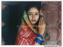 WAITING (manaspattnaik) Tags: people india women veil doorway potrait sari orissa manas potraits oriya potraiture pattnaik