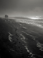 the trail that winds through solitude (manyfires) Tags: blackandwhite bw beach oregon nikon footprints stormy pacificocean shipwreck astoria pacificnorthwest peteriredale iredale