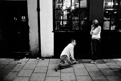 Outside the pub - St Mary Street (Dr Karanka) Tags: street blackandwhite film night 35mm cardiff ilfordhp5 rodinal 175 20c primelens stmarystreet manontheground asahipentaxsp 25min womanstanding fds24hdrkaranka