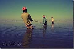 the Art of Being Human (Shabbir Ferdous) Tags: portrait people colour nature water landscape photographer fishermen perspective sylhet bangladesh fishingnet bangladeshi canoneos5d shabbirferdous ef2470mm28lusm hakalukihaor wwwshabbirferdouscom shabbirferdouscom