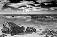 Rocky-Shore (petefoto) Tags: longexposure sea blackandwhite seascape beach portugal clouds sand nikon rocks atlantic coastal filters polariser nd110 09hgrad mygearandmepremium praiadocoelho