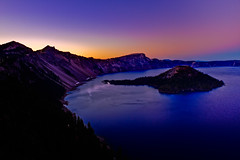 Crater Lake after Sunset (Michael Riffle) Tags: blue sunset sky mountain lake mountains water night oregon island volcano nationalpark clear cascades craterlake wizardisland craterlakenationalpark flickraward platinumpeaceaward flickraward5 prismaticsky