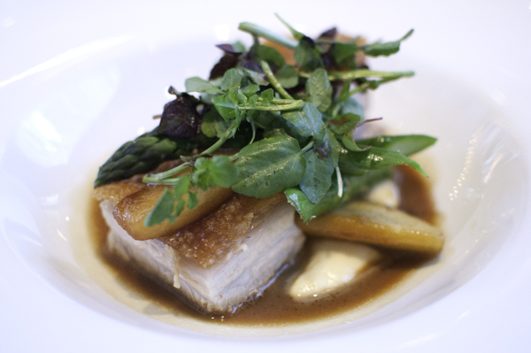 glass brasserie's pork belly with swede puree and roasted apples