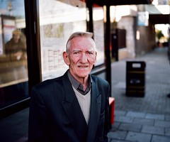 In his Sunday best on a Sunday, Holloway Road (deepstoat) Tags: street portrait london 120 film mediumformat teeth suit roll holloway mamiya7ii kodakportra autaut