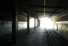 Abandoned Platform (Gowanus) Tags: nyc newyorkcity light sun ny newyork abandoned lines station brooklyn train dark graffiti track glow platform tracks vertigo tunnel line trainstation underneath cieling pillars vanishing freight eastnewyork broadwayjunction freightline abandonedstation bisecting