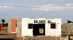 Balance She Been (cowyeow) Tags: poverty africa street old silly bar weird town crazy funny sad african empty wrong prostitution alcohol badsign booze rough taliban decrepit namibia funnysign dilapidated brothel rundown namibian uglybuilding funnyname ruacanafalls ruacana crapsign funnyafrica
