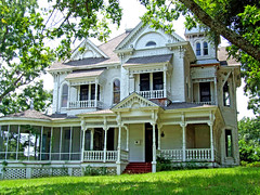 Eclectic home for the lumberman (Texas Finn) Tags: windows white detail architecture tin texas district palestine balcony victorian wrap front historic porch balconies around southside hip gables trim railings spindle easttexas porches supershot threestory allnicethink