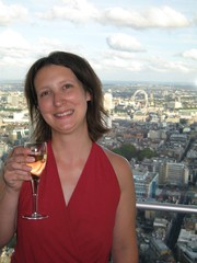 Me and my champagne with the London Eye over my shoulder