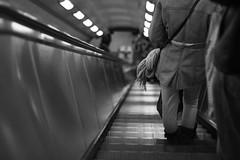 down (Joshua.Sams) Tags: uk england blackandwhite bw london canon subway tube atmosphere londonunderground esculator aperature 50mmprime eos500d
