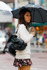 Dreary day (Silentmind8) Tags: street woman hot cute girl rain japan umbrella japanese pretty sad legs wind dreary skirt purse tropical okinawa