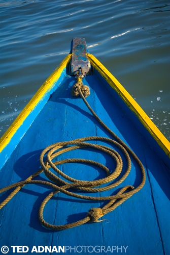 A yellow and blue bow of a passenger boat